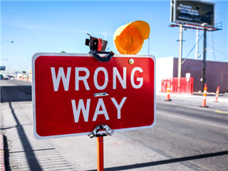 A wrong way sign on a road construction site