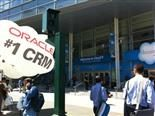 "oracle representatives setting up balloon with ""oracle"" written on it outside Salesforce Dreamforce conference"