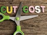 Scissors with words CUT COST word written on wooden background - martech bloat concept