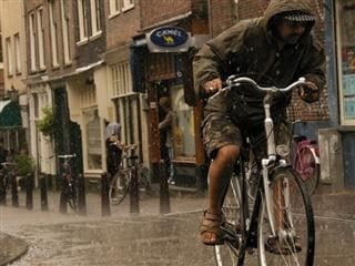 riding bicycle in the rain
