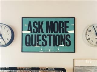 "Sign reading, ""Ask more questions"""