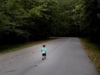child running down the road