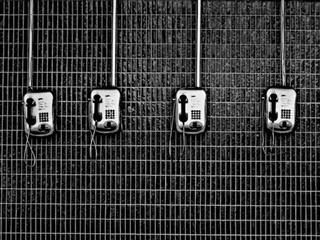 line of pay phones on the wall