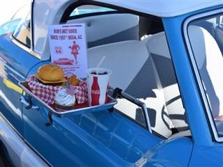 drive through food resting on the side of a blue car