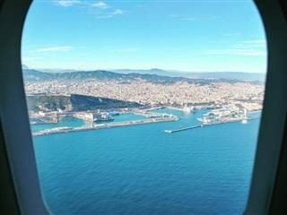 view of Barcelona from a plane window